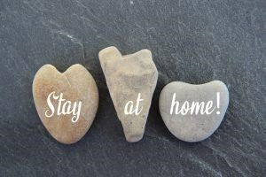 """three stones – """"Stay at home"""" written on them"""